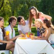 Friends enjoy a picnic at the park — ストック写真