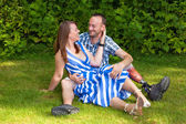 Happy couple sitting on the grass — Stock Photo