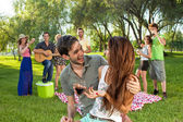 Young couple with their friend in the park — Stock Photo