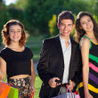 Three stylish teenagers out shopping together. — Stock Photo #42774573