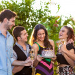Group of teenage friends toasting a birthday girl. — Stock Photo