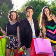Happy teenagers out Christmas shopping. — Stock Photo