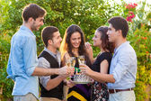 Teenage friends celebrating at a birthday party. — Stock Photo