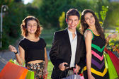 Three stylish teenagers out shopping together.  — Stock Photo
