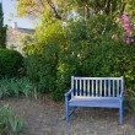 Wooden garden bench — Stock Photo #44789299