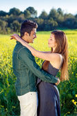 Couple in field of flowers — Stock Photo
