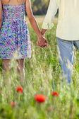 Romantic couple holding hands — Stock Photo