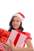 Young happy girl in Christmas Santa hat holding christmas gift — Stock Photo