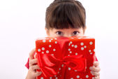 Picture of beautiful little girl with gift boxes. — Stock Photo