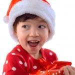 Happy cute little girl in Christmas Santa hat — Stock Photo