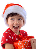 Happy cute little girl in Christmas Santa hat — Stock Photo