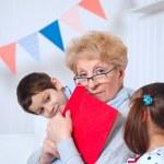 Grandmother and grandchildren — Stock Photo #39980749