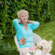 Portrait of an attractive elegant senior woman relaxing and drea — Stock Photo #39980801