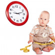 Little boy looking at a clock — Stock Photo