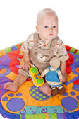 Baby boy on a play mat — Stock Photo