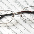 Stock Photo: Eyeglasses on account document