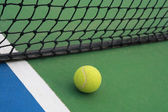 Tennis on court with net — Stock Photo