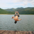 A man jump to river — Stock Photo