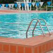 Swimming pool with stair — Stock Photo