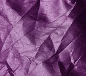 Skrynkliga lila tyg bakgrund — Stockfoto