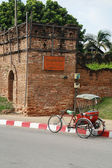 A tricycle and antique Chiang Mai city wall, Thailand — Stock Photo