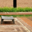 A old wooden seat on garden  — Stock Photo