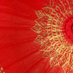 Red gold umbrella, Chiang Mai ,Thailand — Stock Photo