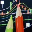 Pencil and candlestick chart — Stock Photo