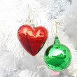 Red heart and green ball , Christmas festival — Stock Photo