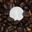 1 yuan coin on coffee bean — Stock Photo