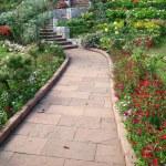 Stone walkway in flower garden — Stock Photo #32444591