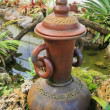Earthenware in garden — Stock Photo
