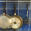 Pan hang on kitchen wall — Stock Photo