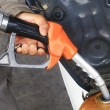 At the gas station pump putting gas into the motorcycle  — Stockfoto