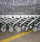 Shopping Carts wheel background — Stock Photo