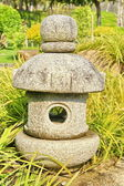 Japanese stone lamp in garden — Stock Photo
