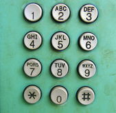 Old phone dial button background — Stock Photo
