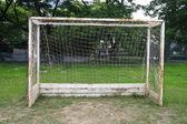 Old soccer goal in field — Stock Photo