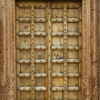 Wooden door with ancient floral patten. — Stock Photo