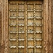 Stock Photo: Wooden door with ancient floral patten.