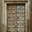 Old dilapidated wooden door — Stock Photo