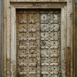 Stock Photo: Old dilapidated wooden door