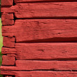 Stock Photo: Red painted, hand carved old log wall, texture material.
