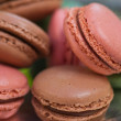 Macaroon pile on vintage silver plate. — Stock Photo