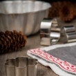 Gingerbread cutters and Christmas linen on wooden table with bak — Stock Photo