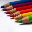 Stock Photo: Rainbow coloring pencils on empty white paper.