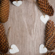 Heart shaped Christmas decorations and spruce cones frame. — Stock Photo