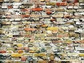 Old brick wall colorfully painted — Stock Photo