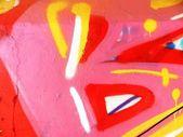 Gamla väggen med färgglad graffiti — Stockfoto