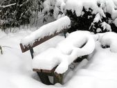 Bench covered with snow — 图库照片